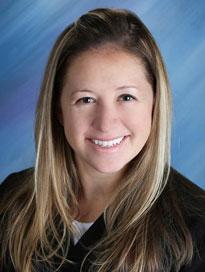 Nurse practitioner Brandi Schaefer wearing black sweater