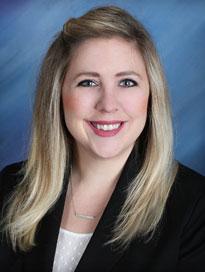 PA Emily Nadler wearing white blouse with black blazer