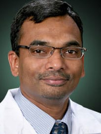male doctor wearing glasses and white coat